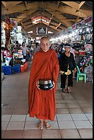 Buddhist Monk doing alms round in Ben Thanh Market. Ho Chi Minh City, Vietnam