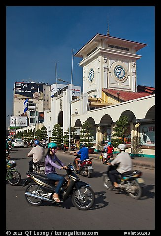 Chaotic motorcycle traffic outside Ben Thanh Market. Ho Chi Minh City, Vietnam (color)