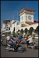 Chaotic motorcycle traffic outside Ben Thanh Market. Ho Chi Minh City, Vietnam ( color)