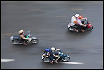 Motorbike riders seen from above with speed blur. Ho Chi Minh City, Vietnam ( color)