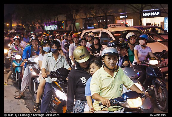 Riders waiting for traffic light at night. Ho Chi Minh City, Vietnam