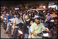 Riders waiting for traffic light at night. Ho Chi Minh City, Vietnam (color)