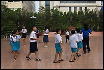 Children walking in circle in park. Ho Chi Minh City, Vietnam ( color)
