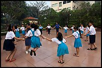 Children playing in circle in park. Ho Chi Minh City, Vietnam ( color)