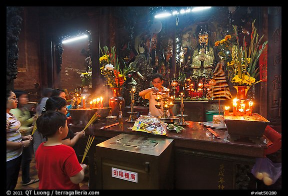 Man lightening candles, Jade Emperor Pagoda, District 3. Ho Chi Minh City, Vietnam