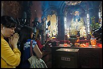 Women worshipping Thang Hoang, Phuoc Hai Tu pagoda, District 3. Ho Chi Minh City, Vietnam ( color)