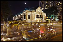 Motorcycles and Opera House at night. Ho Chi Minh City, Vietnam (color)