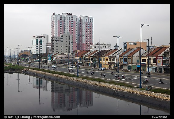 Expressway and high rise on the banks of the Saigon Arroyau. Cholon, Ho Chi Minh City, Vietnam (color)