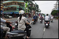 Motorcycle traffic seen from the street. Ho Chi Minh City, Vietnam (color)