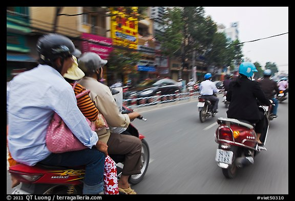 Motorcycle traffic seen from a motorcyle in motion. Ho Chi Minh City, Vietnam (color)