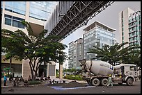 Asphalt truck and new urban area, Phu My Hung, District 7. Ho Chi Minh City, Vietnam