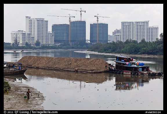 River scene and high rise towers in construction, Phu My Hung, district 7. Ho Chi Minh City, Vietnam (color)