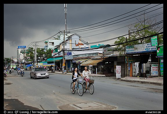 Street with moonson clouds, District 7. Ho Chi Minh City, Vietnam (color)