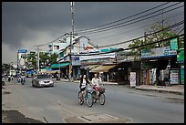Street with moonson clouds, district 7. Ho Chi Minh City, Vietnam ( color)