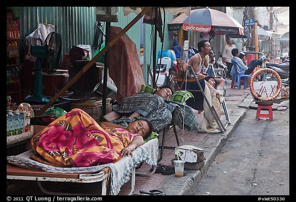 Vendors sleeping on the street at dawn. Ho Chi Minh City, Vietnam (color)
