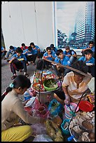 Food vendor preparing breakfast on the street. Ho Chi Minh City, Vietnam (color)