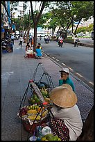 Women selling fruit on a large boulevard. Ho Chi Minh City, Vietnam