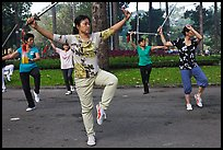 People practicisng Tai Chi with swords, Cong Vien Van Hoa Park. Ho Chi Minh City, Vietnam ( color)