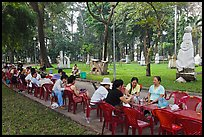 Outdoor refreshments served in front of sculpture garden, Cong Vien Van Hoa Park. Ho Chi Minh City, Vietnam (color)