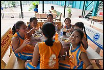 Girls athetics team eating, Cong Vien Van Hoa Park. Ho Chi Minh City, Vietnam (color)