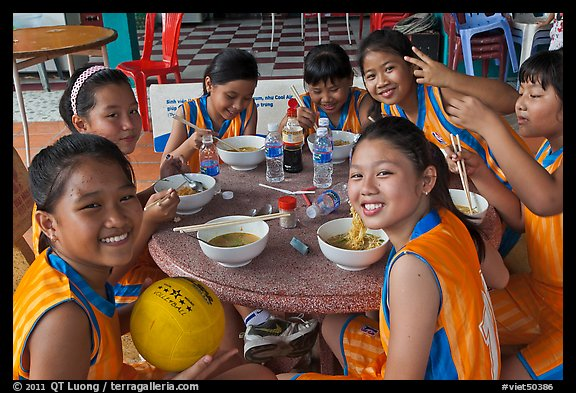 Girls sports team eating, Cong Vien Van Hoa Park. Ho Chi Minh City, Vietnam (color)
