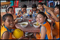 Girls sports team eating, Cong Vien Van Hoa Park. Ho Chi Minh City, Vietnam ( color)