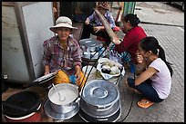 Woman offering soft tofu on the street. Ho Chi Minh City, Vietnam (color)