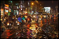 Flooded street and light reflections. Ho Chi Minh City, Vietnam (color)