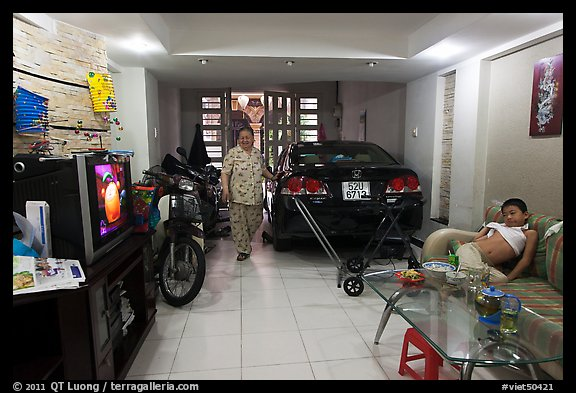 Picture/Photo: Living Room Used As Car And Motorbike Garage. Ho Chi Minh  City, Vietnam