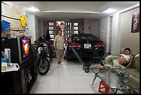 Living room used as car and motorbike garage. Ho Chi Minh City, Vietnam (color)