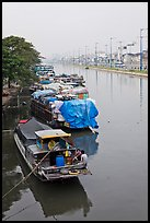 Mariners aboard barges, Saigon Arroyau. Cholon, Ho Chi Minh City, Vietnam ( color)
