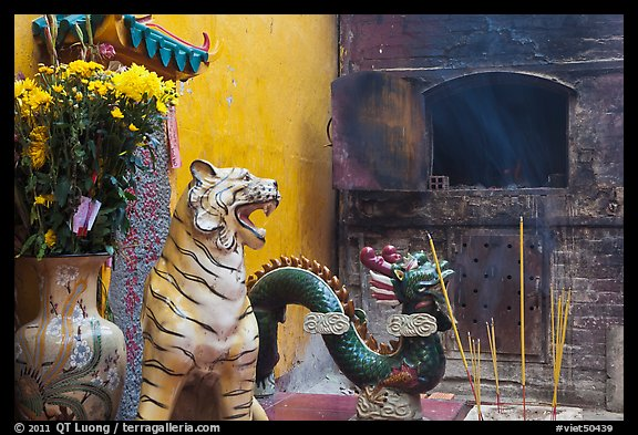 Ceramic tiger, dragon, and oven, Quan Am Pagoda. Cholon, District 5, Ho Chi Minh City, Vietnam (color)