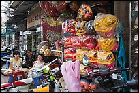 Shop selling dragon heads used for traditional dancing. Cholon, Ho Chi Minh City, Vietnam ( color)