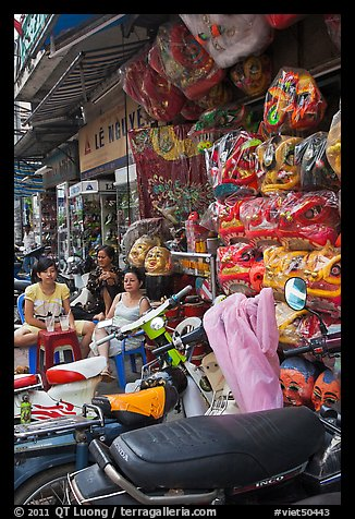 Store selling traditional dragon masks. Cholon, Ho Chi Minh City, Vietnam (color)