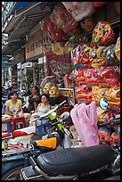 Store selling traditional dragon masks. Cholon, Ho Chi Minh City, Vietnam
