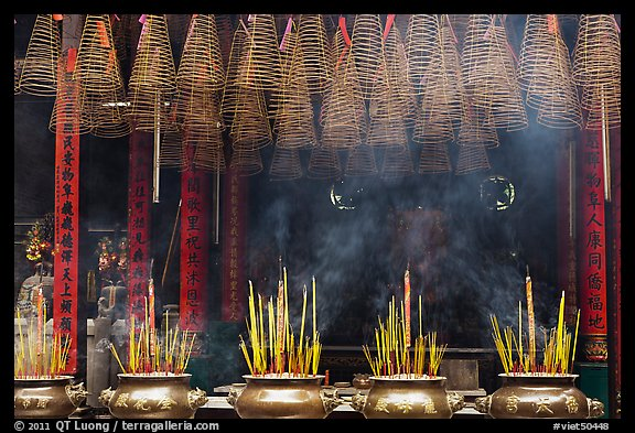 Urns, incense coils, and incense smoke, Thien Hau Pagoda. Cholon, District 5, Ho Chi Minh City, Vietnam