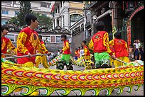 Dancers animating dragon, Thien Hau Pagoda. Cholon, District 5, Ho Chi Minh City, Vietnam ( color)