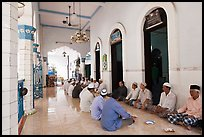 Men sharing food in gallery, Cholon Mosque. Cholon, District 5, Ho Chi Minh City, Vietnam (color)