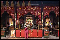 Woman at altar, Tam Son Hoi Quan Pagoda. Cholon, District 5, Ho Chi Minh City, Vietnam