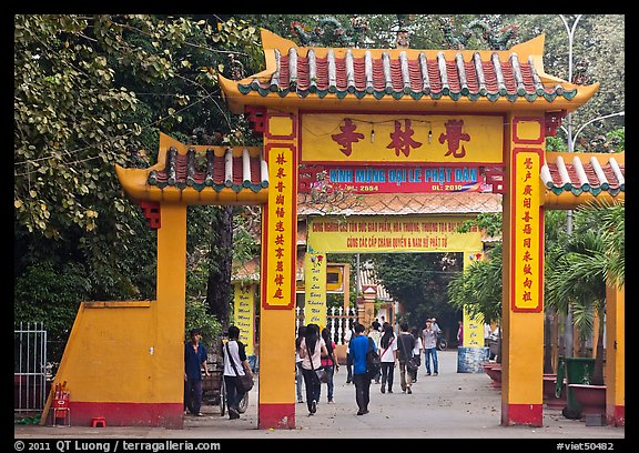 People walking through gates, Giac Lam Pagoda, Tan Binh District. Ho Chi Minh City, Vietnam (color)