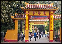 People walking through gates, Giac Lam Pagoda. Ho Chi Minh City, Vietnam ( color)