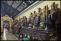Row of statues, Giac Lam Pagoda. Ho Chi Minh City, Vietnam ( color)