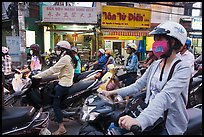 Commuters on motorcyles in stopped traffic. Ho Chi Minh City, Vietnam (color)