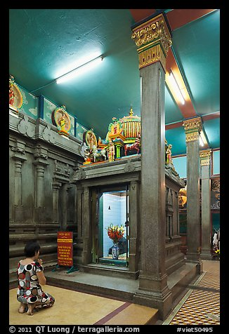 Worshipping inside Mariamman Hindu Temple. Ho Chi Minh City, Vietnam (color)