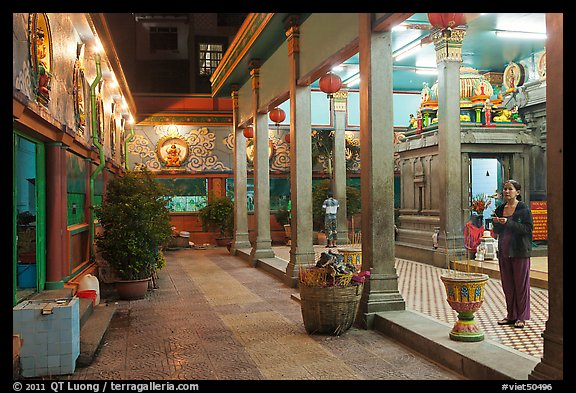 Woman in prayer, inside gallery, Mariamman Hindu Temple. Ho Chi Minh City, Vietnam (color)