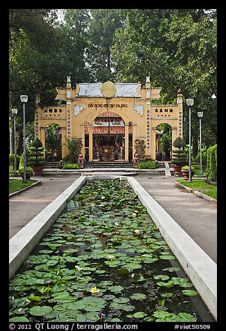 Lilly pond and temple gate, Van Hoa Park. Ho Chi Minh City, Vietnam (color)