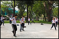 Schoolboys playing a feet badminton game, Cong Vien Van Hoa Park. Ho Chi Minh City, Vietnam (color)