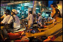 Motorcyle riders in traffic gridlock. Ho Chi Minh City, Vietnam (color)
