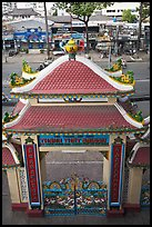 Exterior gate and street from above, Saigon Caodai temple. Ho Chi Minh City, Vietnam (color)