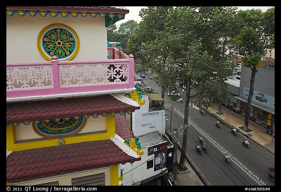 Front tower and street, Saigon Caodai temple, district 5. Ho Chi Minh City, Vietnam (color)